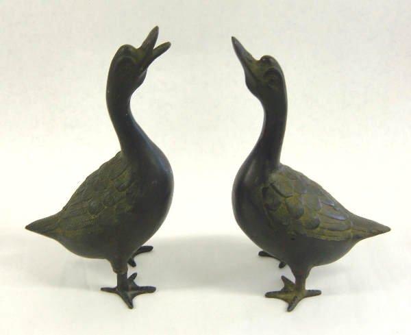 25: White metal Oriental Style Ducks