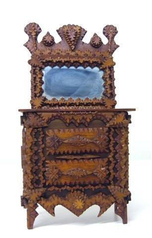 96: Folk tramp art. Two-drawer doll dresser.