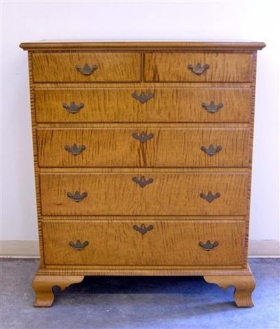 185: Tiger maple Chippendale style chest