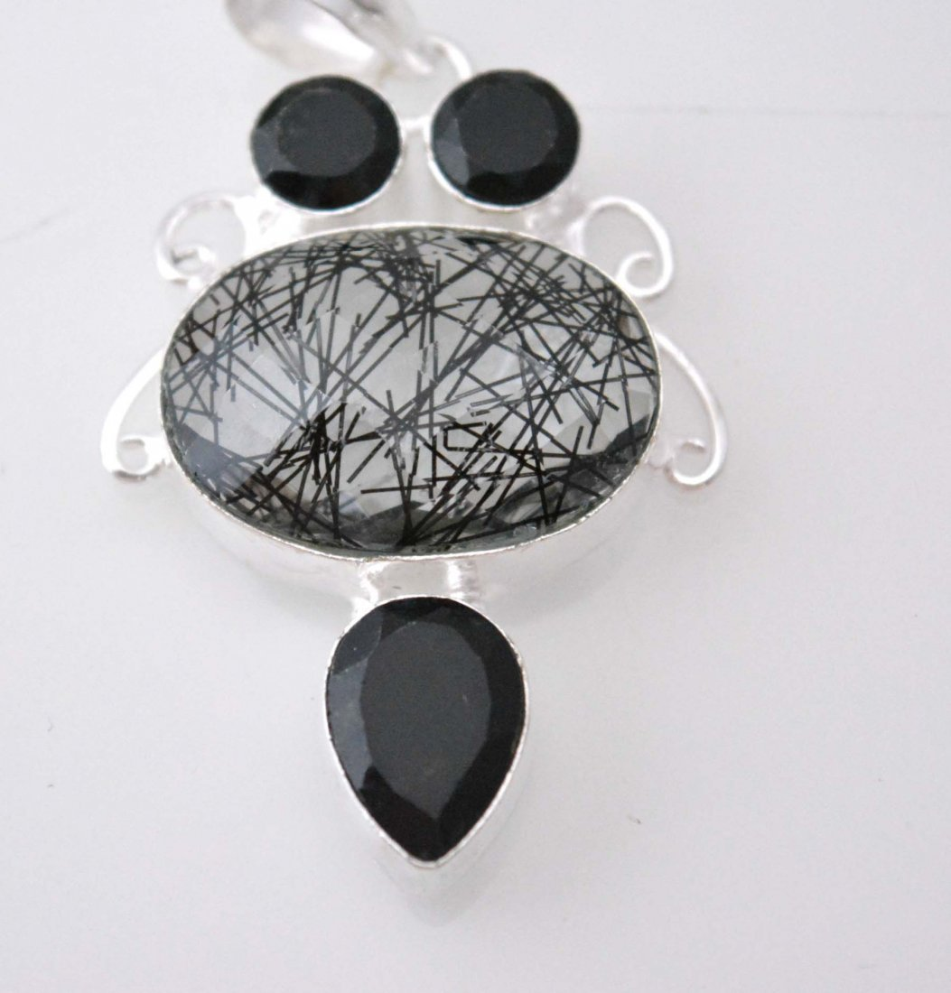 Fabulous Look Pendant With Rutile Quartz-Black Onyx