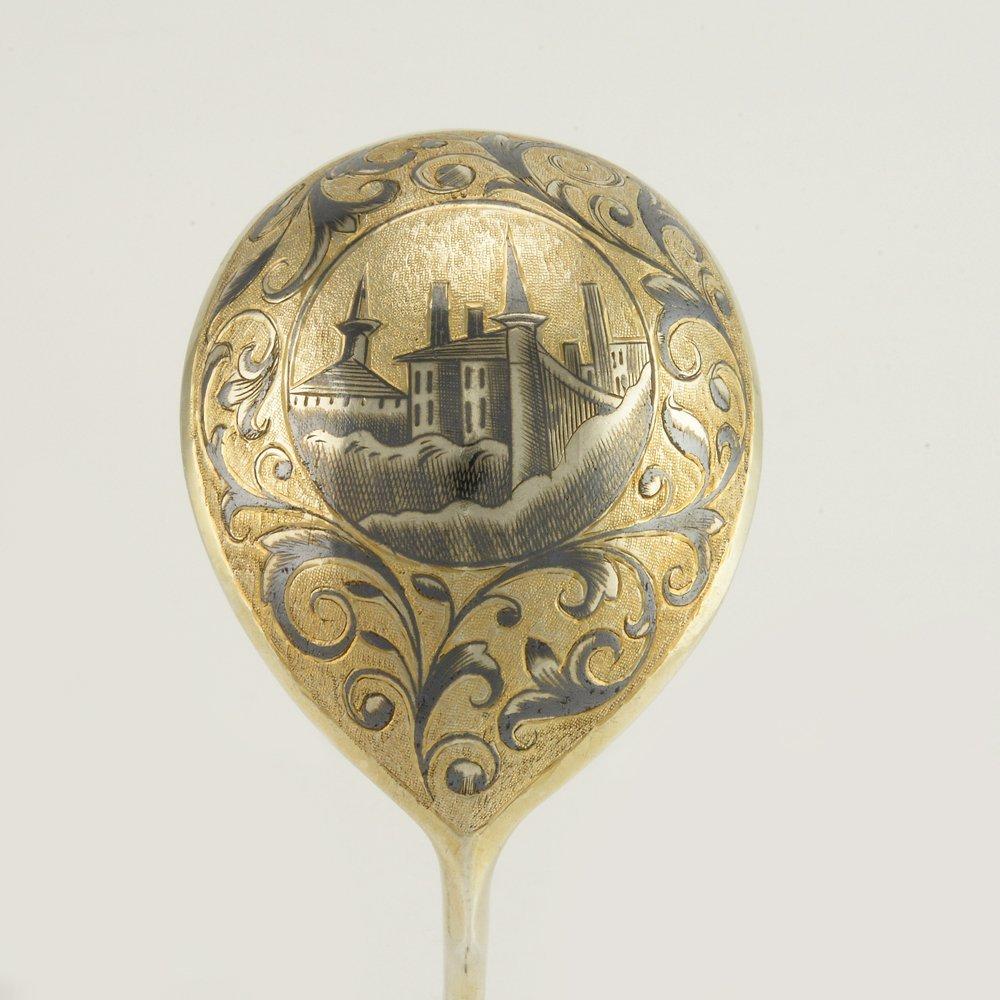 An 1846 Russian gilded silver niello serving spoon
