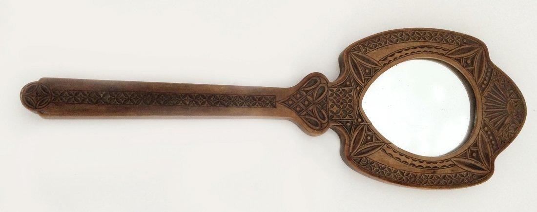 Russian kustar folk art carved wood hand mirror, c1900