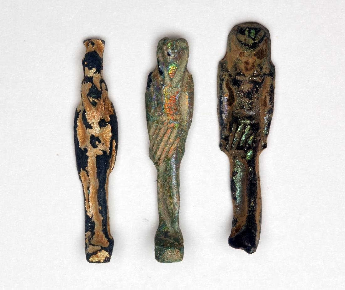 A Group of 3 Egyptian Iridescent Glass Deity Amulets