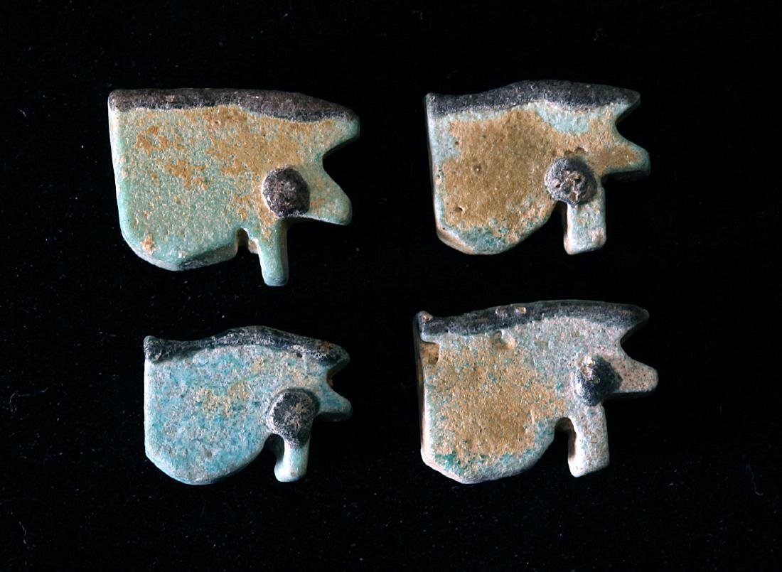 A Group of 4 Egyptian Faience Eyes of Horus