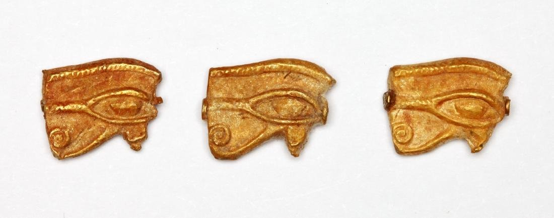 A Group of 3 Egyptian Gold Wedjat Eye Amulets