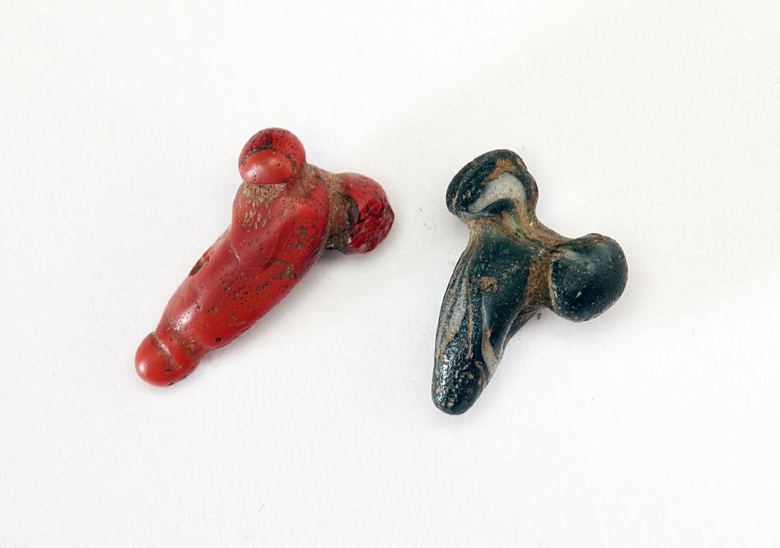 A Group of 2 Egyptian Glass Phallic Amulets