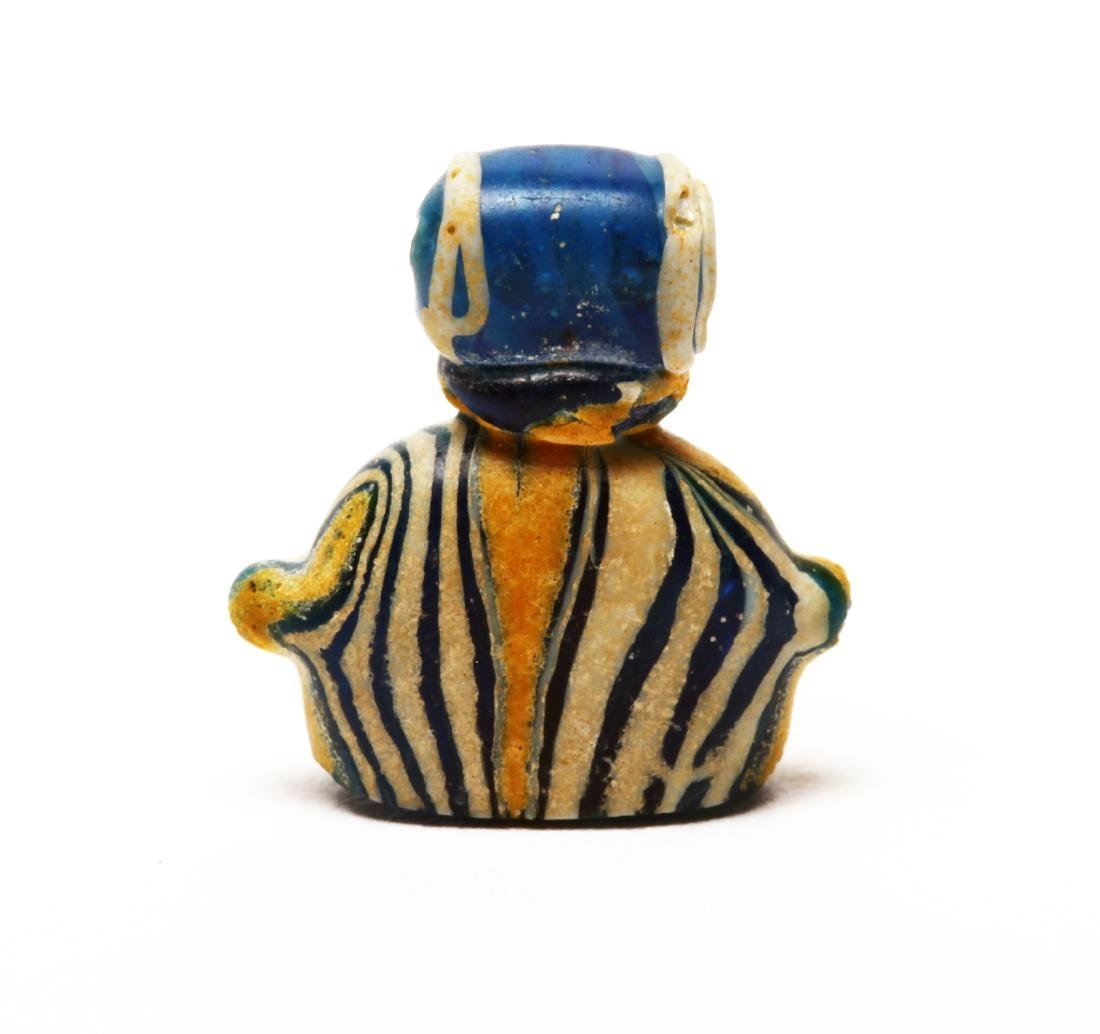 An Egyptian Glass Heart Amulet