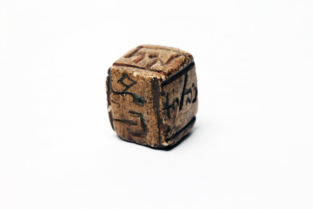 An Ancient Stone Gaming Dice (Die)