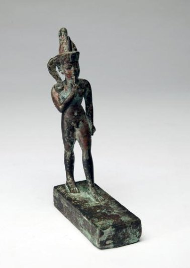 An Egyptian Bronze Figure of Striding Harpocrates