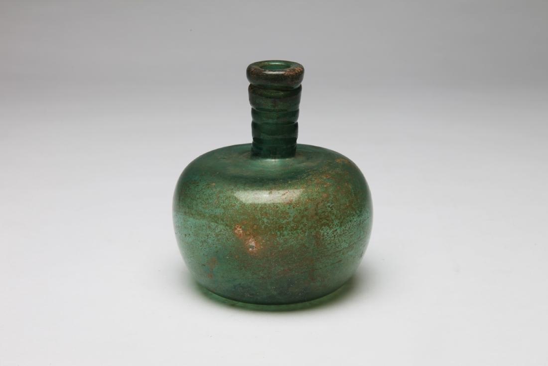 An Ancient Green Glass Bottle