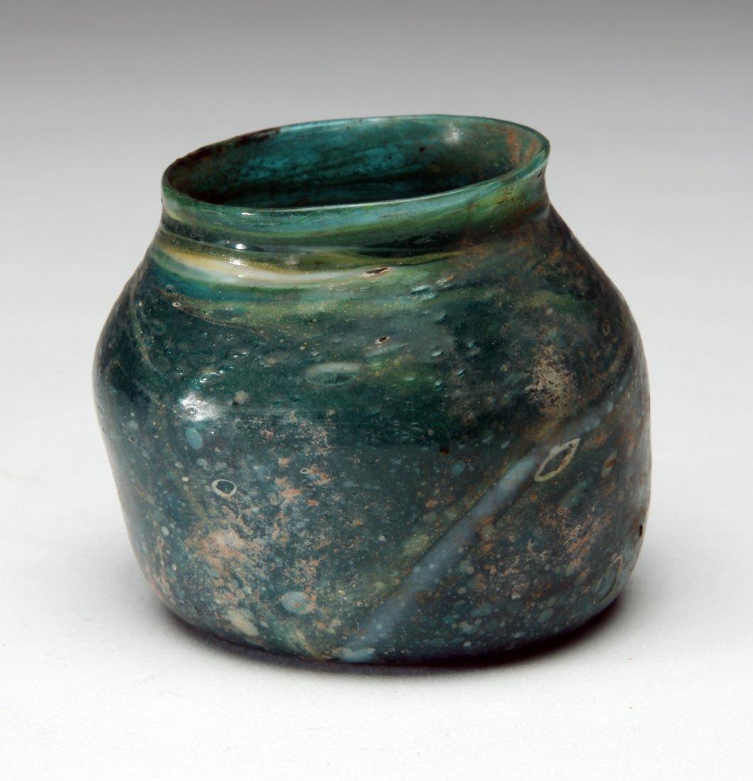 An Ancient Blue -Green Glass Jar - 2