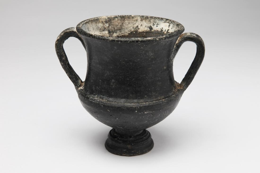 An Etruscan Bucherro Kantharos