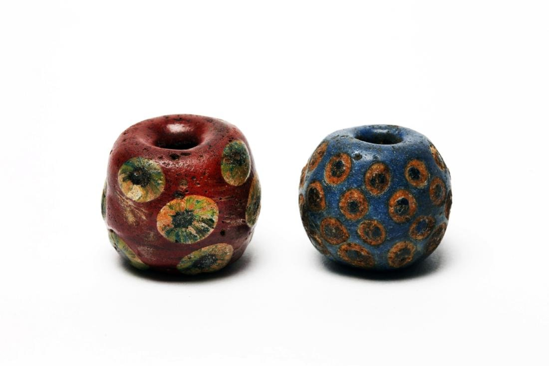 A Group of 2 Massive Ancient Glass Eye Beads