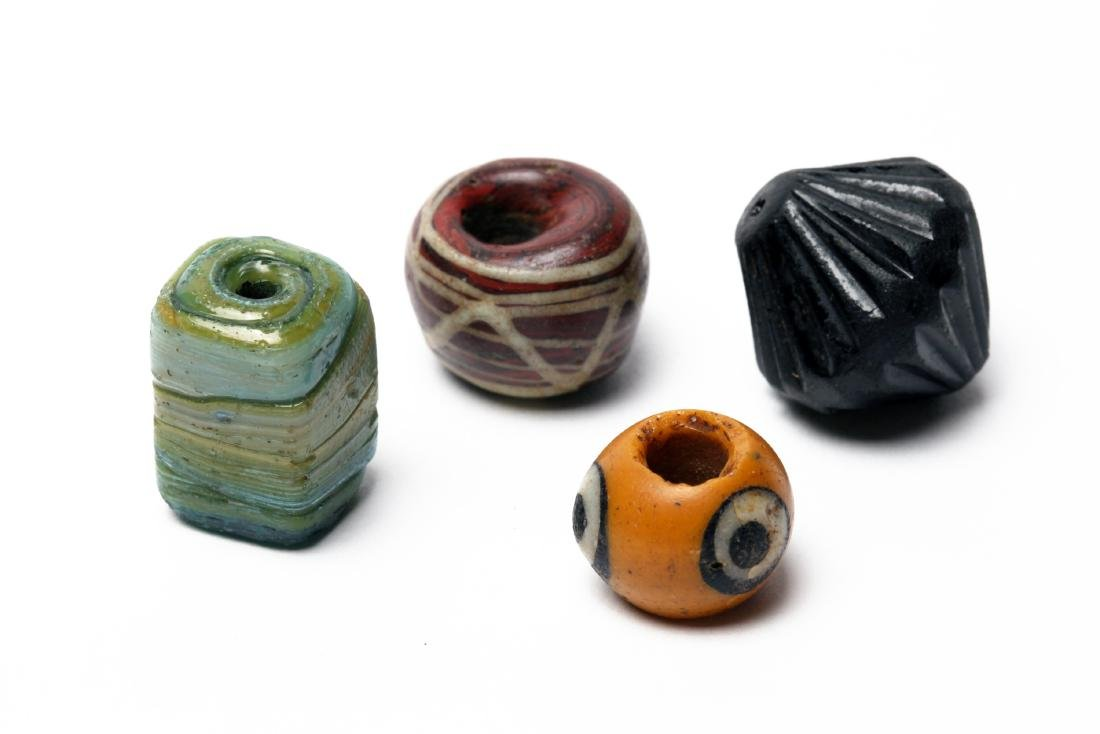 A Group of 4 Large Ancient Glass Beads