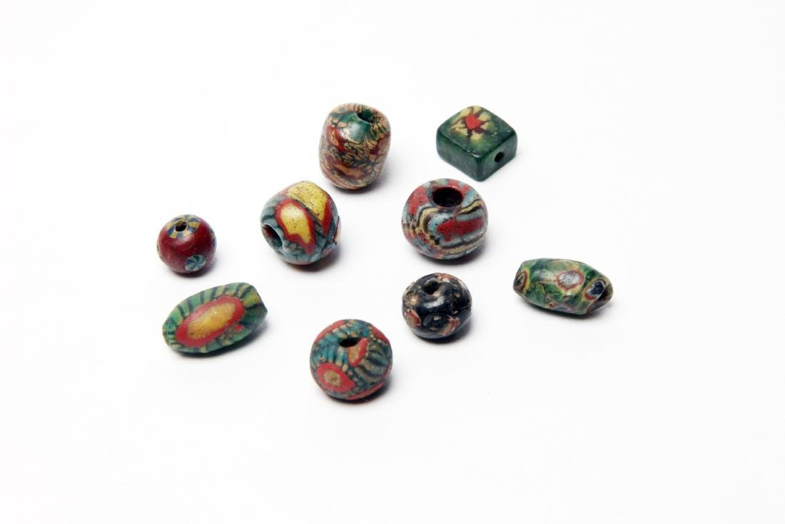 A Group of 9 Ancient Mosaic Glass Eye Beads