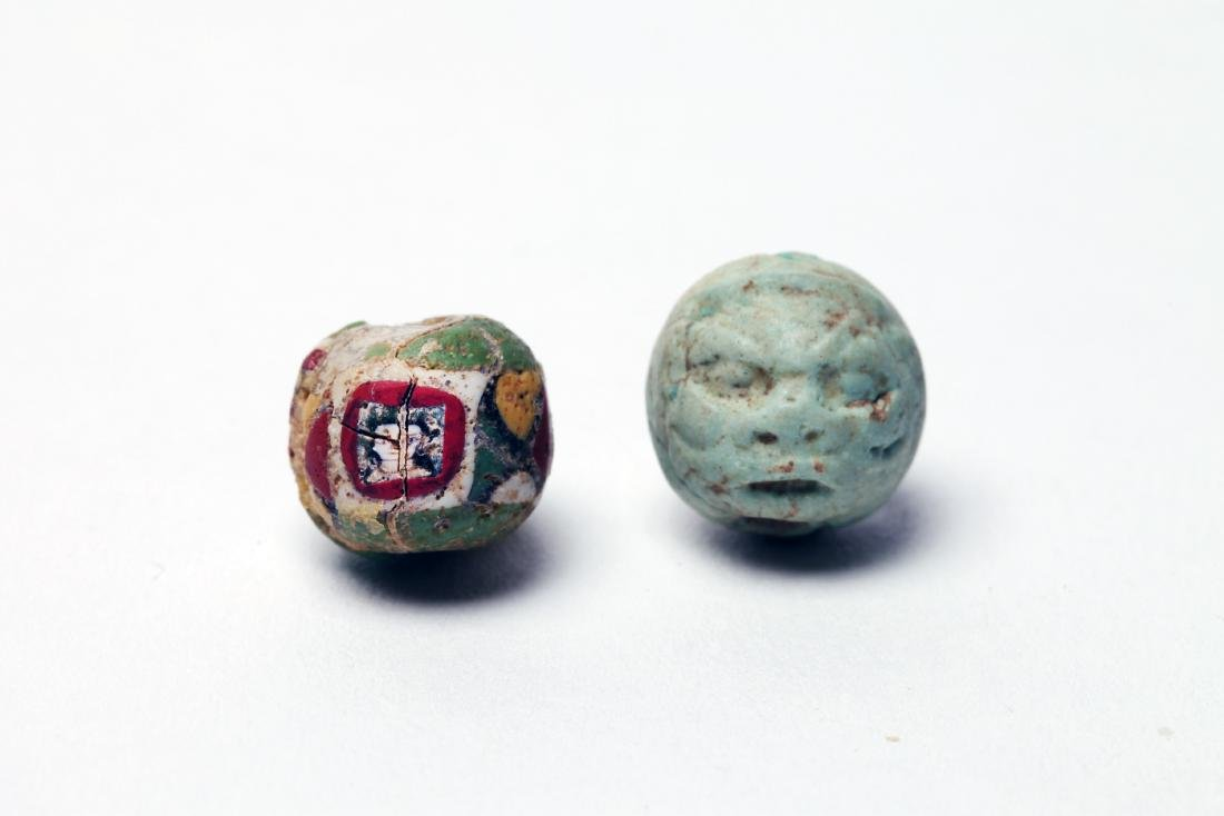 A Group of 2 Rare Ancient Face Beads