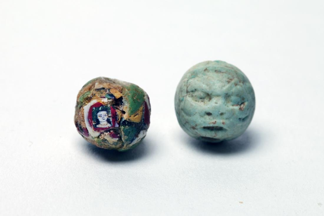 A Group of 2 Rare Ancient Face Beads - 2