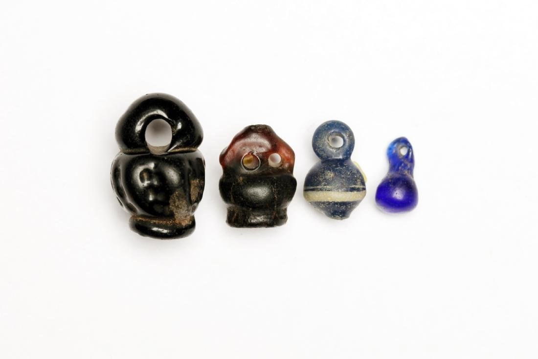 A Group of 4 Ancient Glass Basket Beads