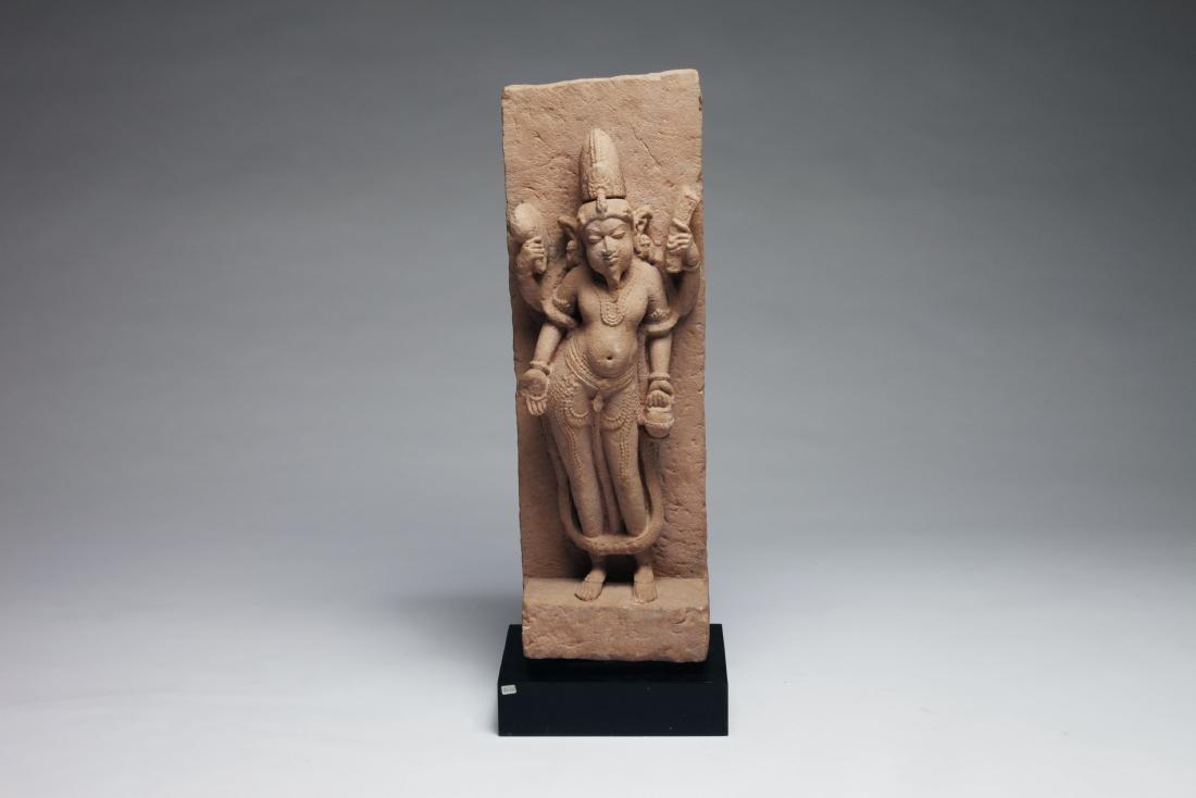 An Indian Sandstone Figure of a Male Deity