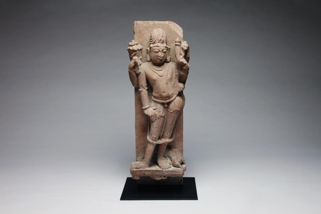 An Indian Sandstone Figure of a Male Deity