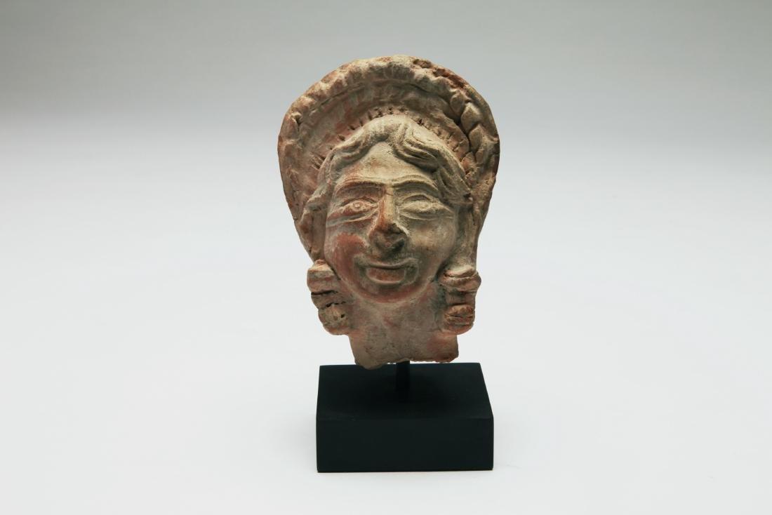 A Terracotta Head of Woman