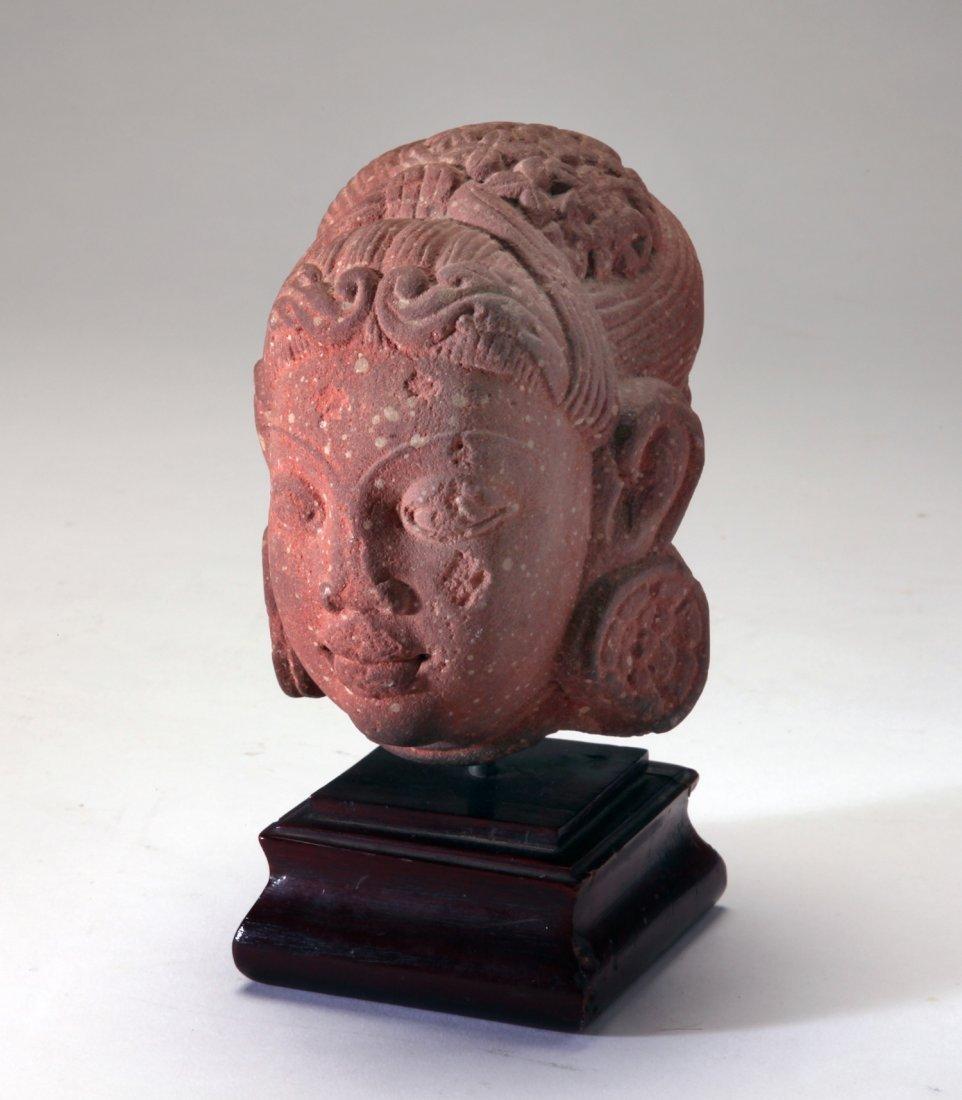 A Mottled Red Sandstone Head of Goddess