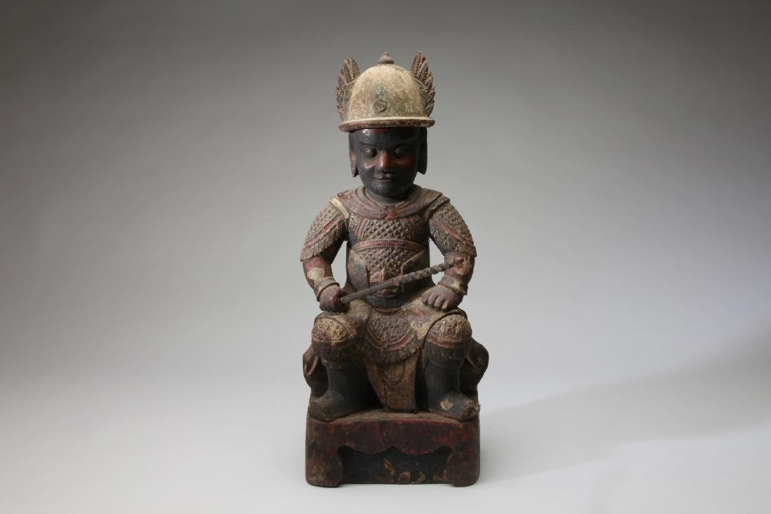 A Large Chinese Polychrome Wood Seated Figure