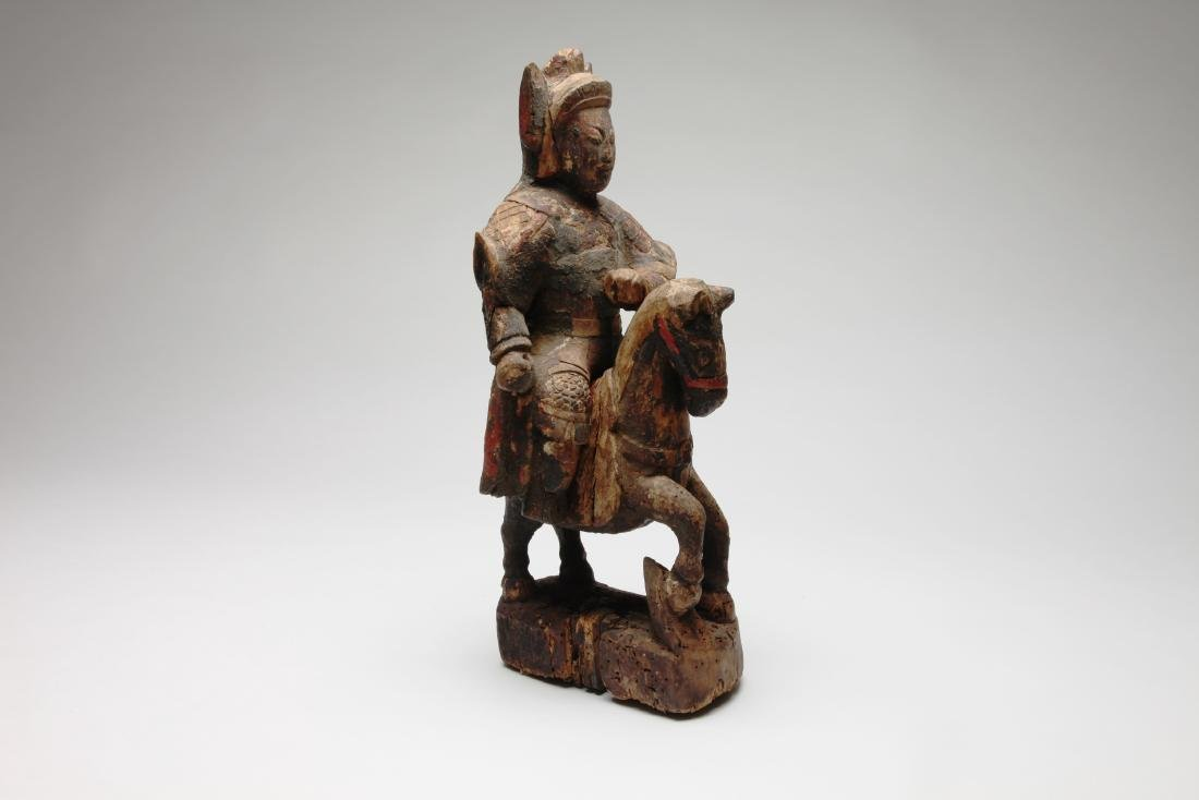 A Seated Chinese Polychrome Wood Equestrian Figure