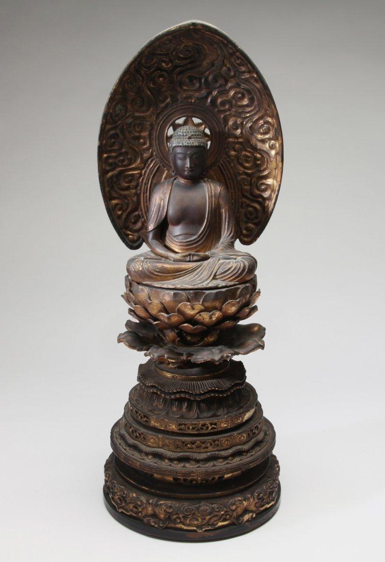 A Japanese Gilt Wood Seated Buddha