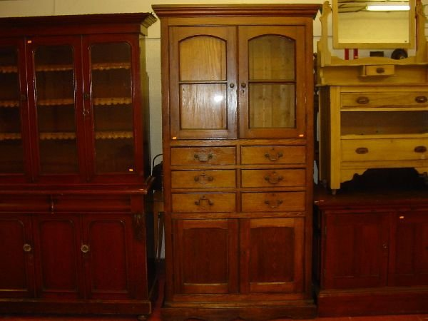 3: A tall pitch pine one piece bookcase having two uppe