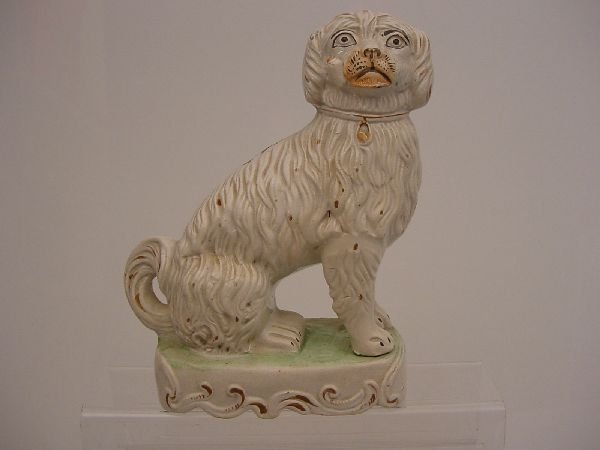 173: A 19th Century white Staffordshire pottery dog wit