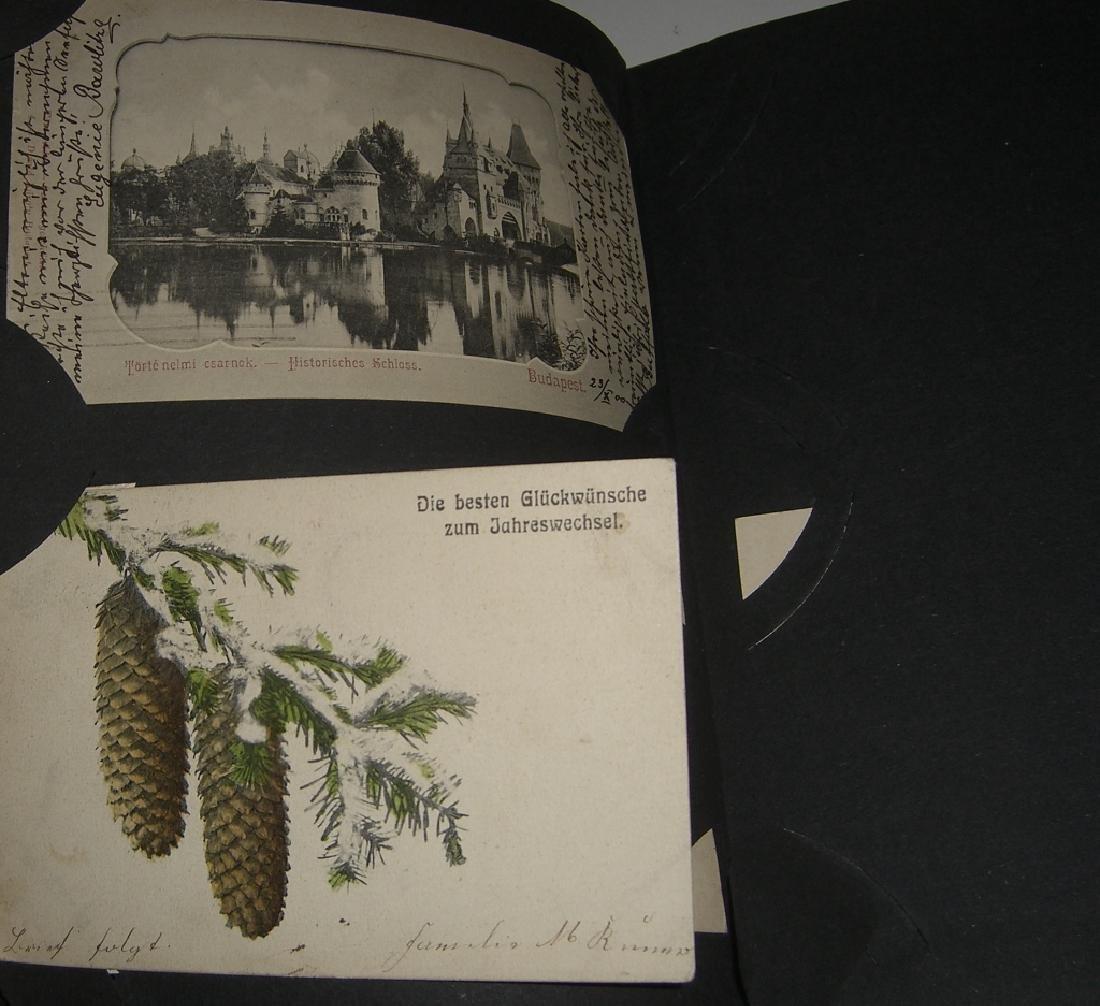 115 postcards in scrapbook - 10