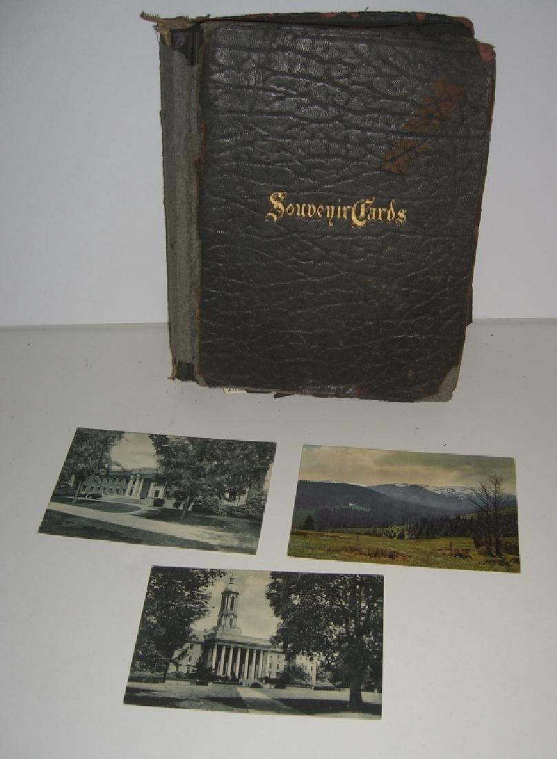 115 postcards in scrapbook