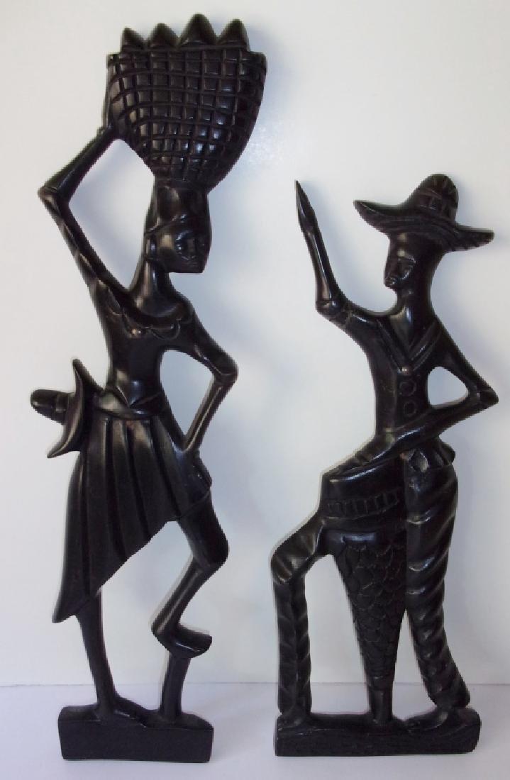 2 vintage Haitian hand carved figures