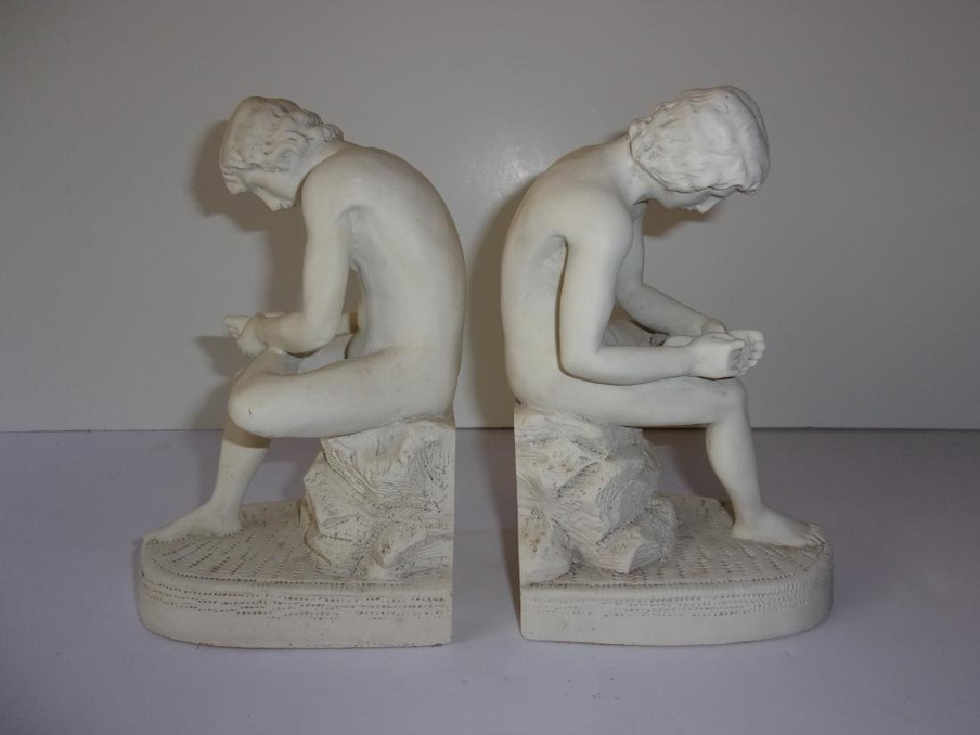 Pair of male seated bookends