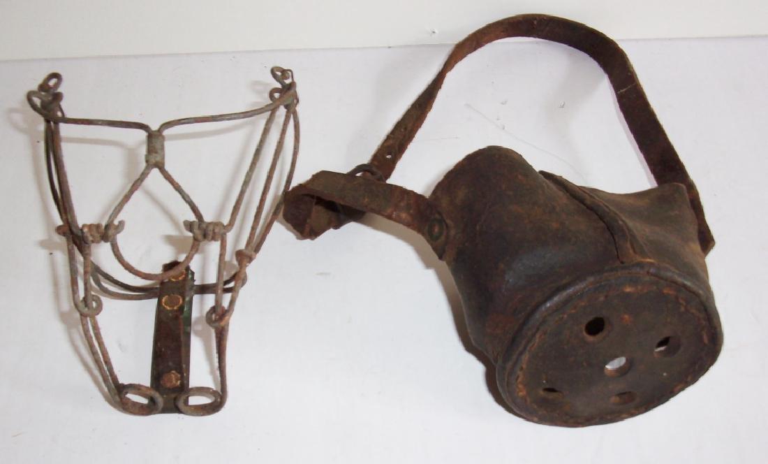 2 antique dog muzzles
