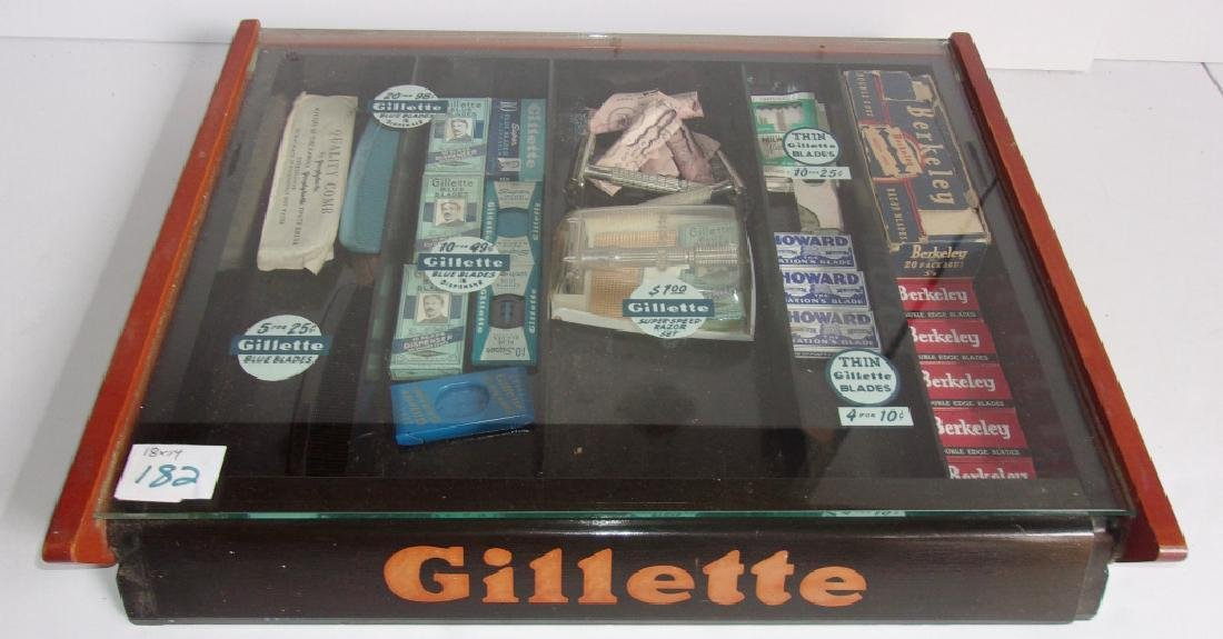 vintage Gillette display case with contents