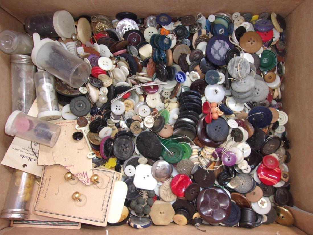 large collection of assorted vintage buttons.