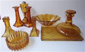 8 piece mid century amber glass lot
