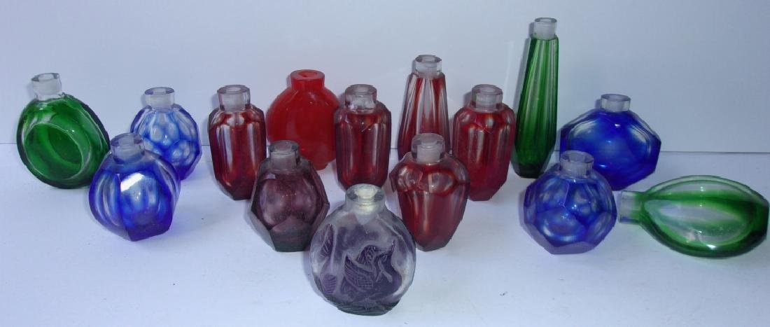 15 assorted colored glass perfume bottles