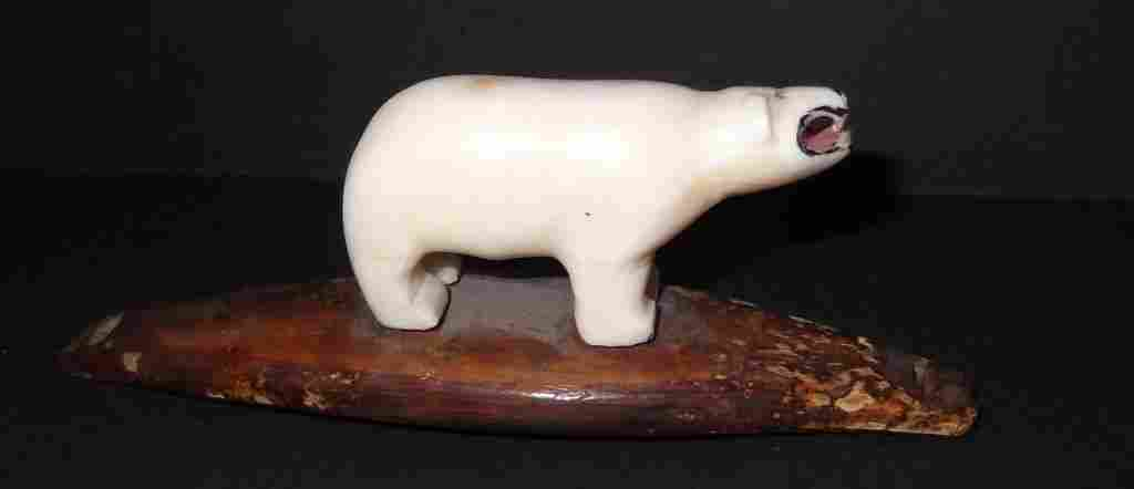 Inuit carved whale's tooth bear figure