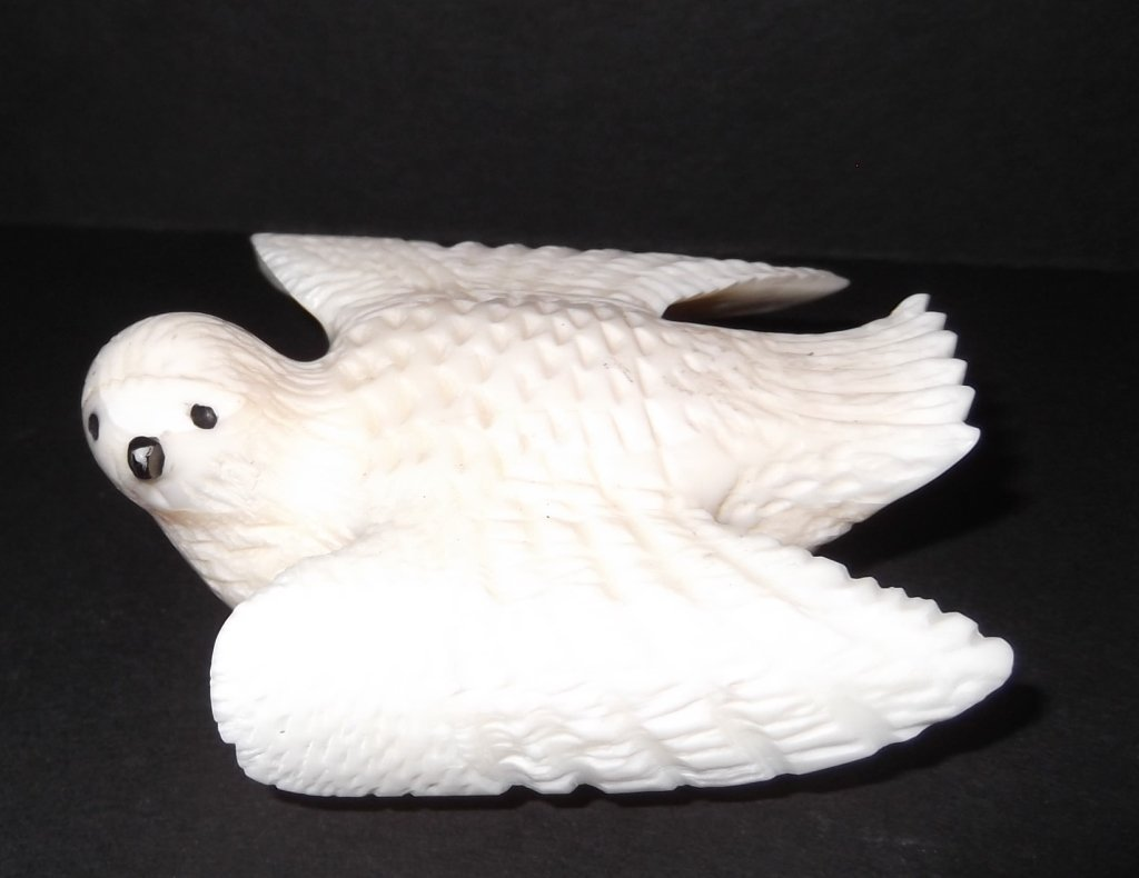 Inuit carved whale's tooth owl figure