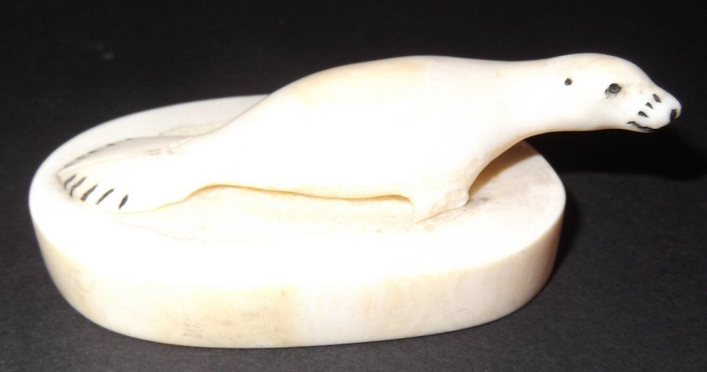 Carved whale's tooth