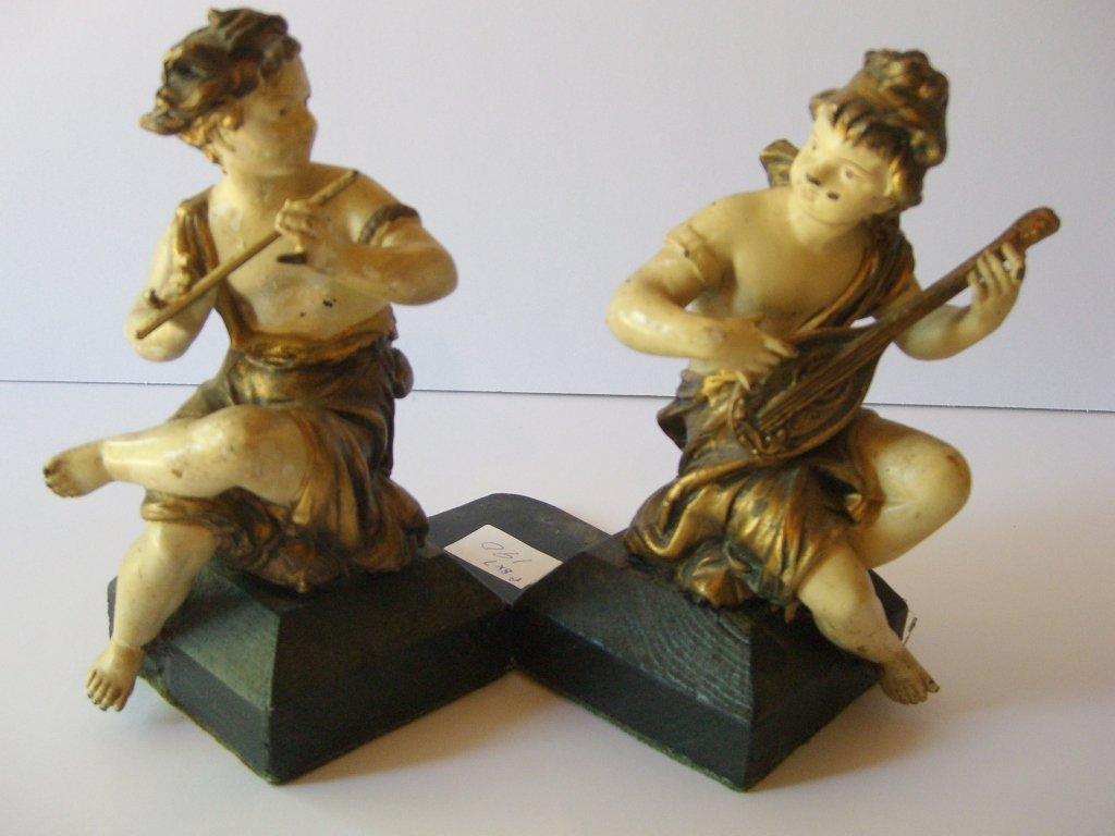 boy & girl playing musical instruments bookends