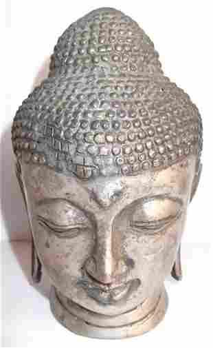 Large metal Buddha head