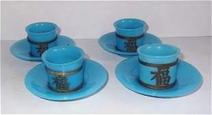 Set of 4 Oriental cups & saucers