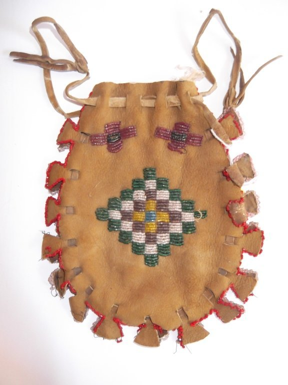 Vintage Apache beaded hide pouch