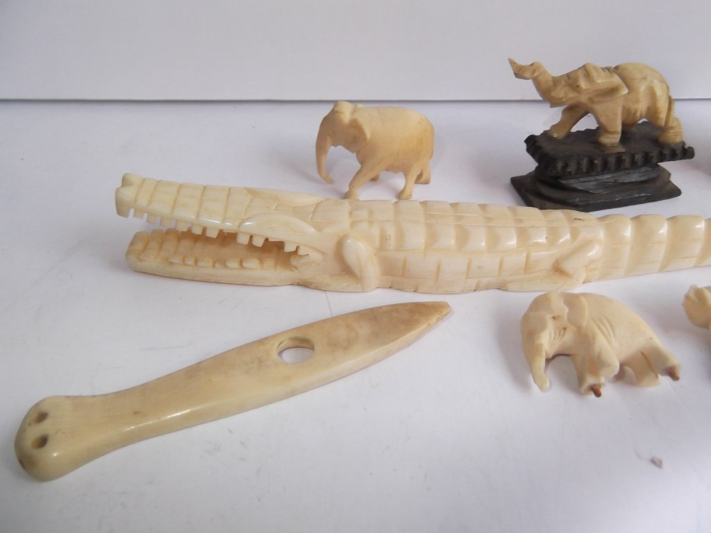 8 assorted carved bone pieces - 6