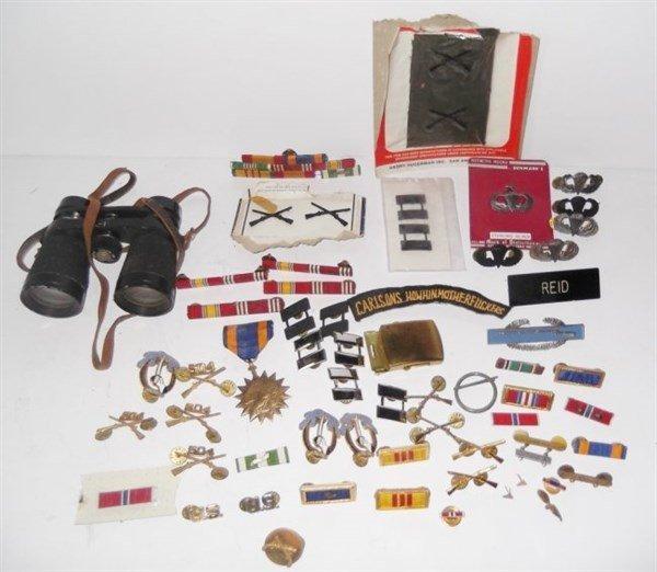 Military pins, badges, belt buckle.