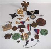 Collection of assorted  items pins medals